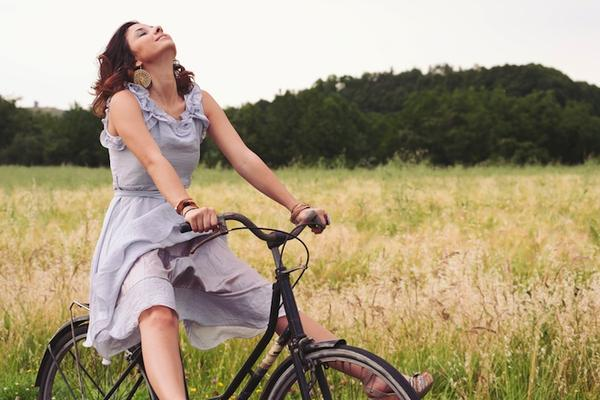 Woman Riding A Bike In Country Road