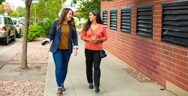 two women walking and talking