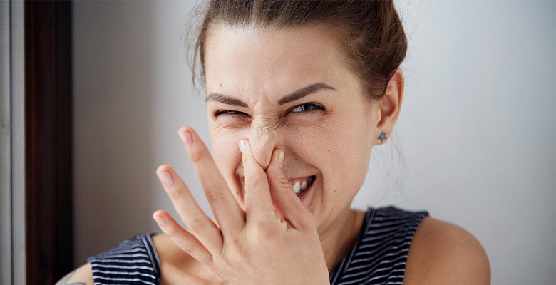 woman cover her nose because of bad smell